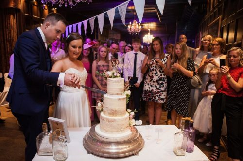 Groom and Bride Cutting the cake