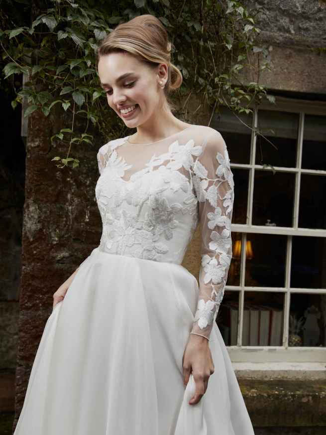 Azalea by Lyn Ashworth, A-Line wedding dress gown, full swishy skirt, lace overlay with pearl sparkle flowers