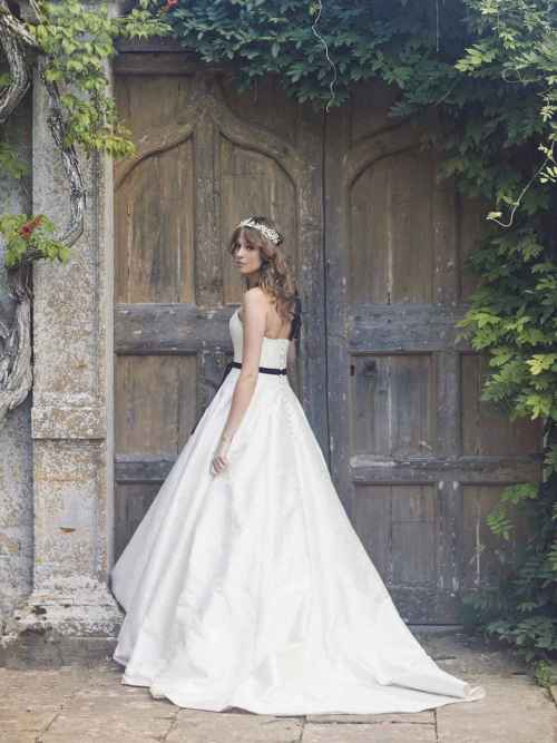 Duchy wedding dress gown by Lyn Ashworth has simple clean lines, sweetheart neckline, cinched in waist and a full Mikado skirt.