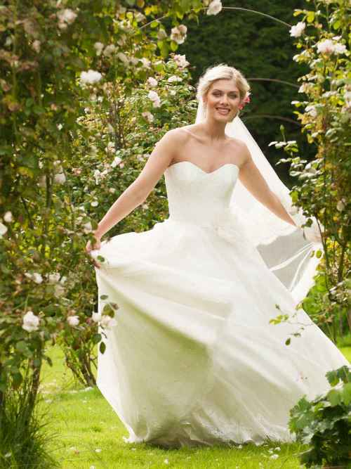 English Rose by Lyn Ashworth Ball gown wedding dress by Lyn Ashworth, structured bodice, lace overlay, full billowing lace edged silk skirt