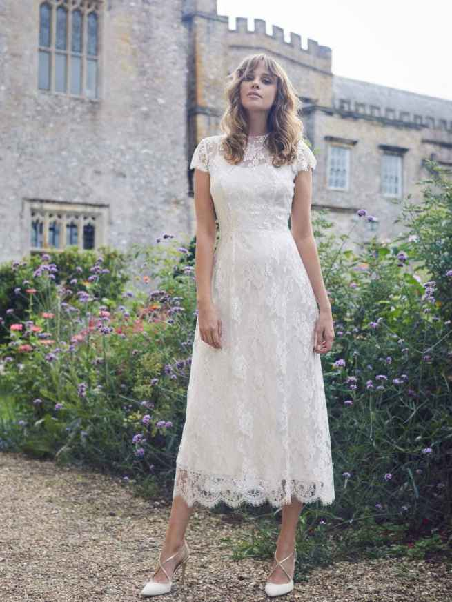 Hamstall by Lyn Ashworth is a sheath wedding dress with French lace, soft satin under slip, cap sleeves, button back, in full or ¾ length