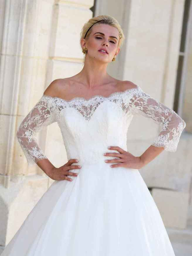Hearts Desire by Lyn Ashworth ball gown silhouette wedding dress, off-the-shoulder beaded French lace, light silk satin organza flowing skirt.