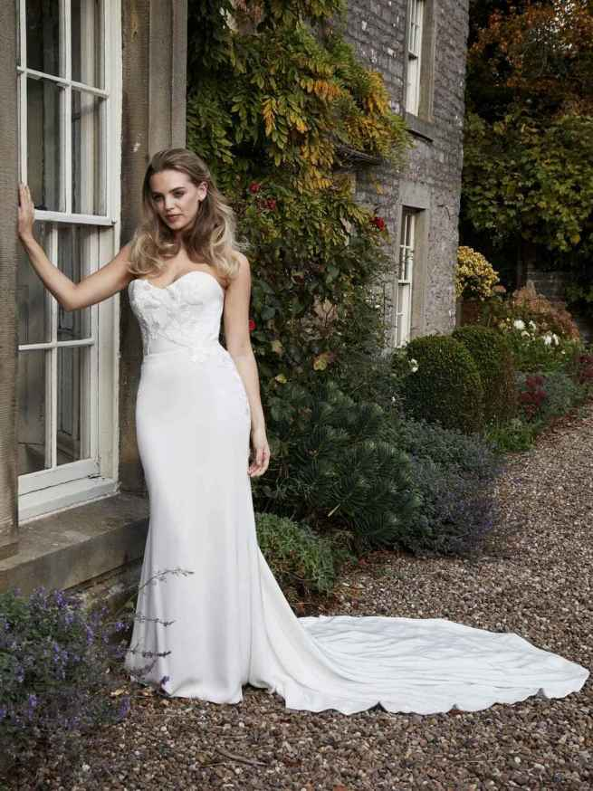 Iris by Lyn Ashworth fitted mermaid wedding dress in a beautiful crepe, with stunning train detail, hand-applied appliqué flowers in sparkle pearls, textured bodice and skirt
