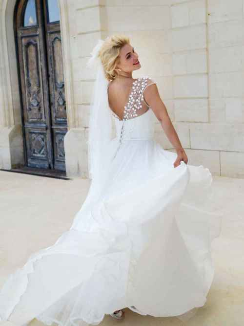 Love's Promise by Lyn Ashworth is a beautiful ball gown with delicate and understated applique leaf detail on the tulle overlay and the silk satin organza