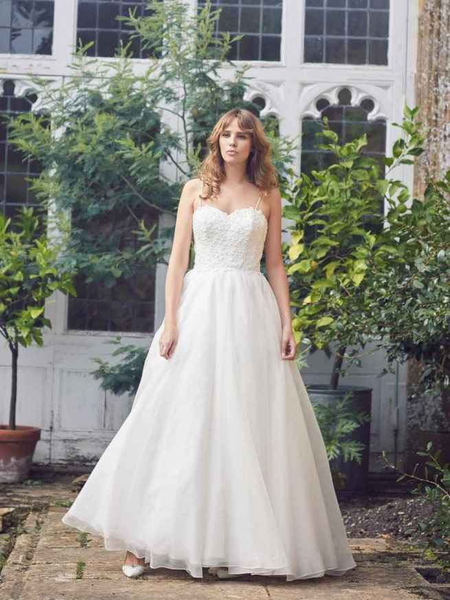 Sudbury ball gown wedding dress by Lyn Ashworth has a boned bodice, full organza swishy skirt and is adorned with delicate 3D floral appliqués.