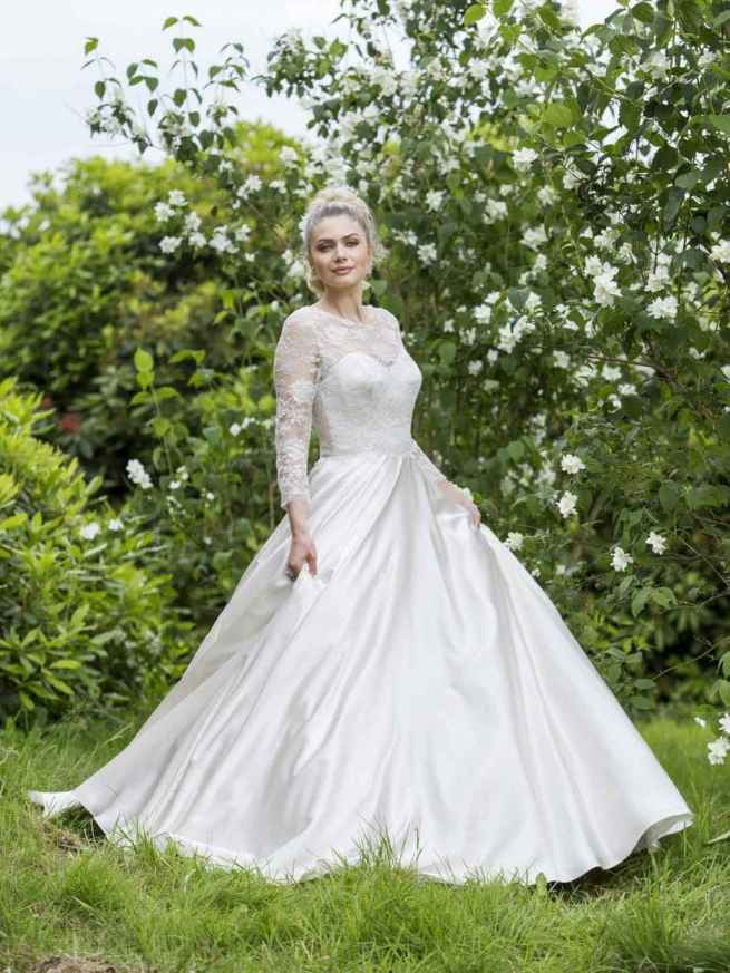 Summertime Haze by Lyn Ashworth ball gown wedding dress, signature billowing skirt, boned bodice, a soft and delicate lace jacket