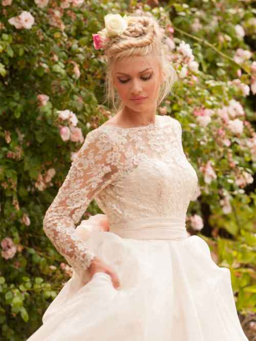 Windsor Halls by Lyn Ashworth ball gown wedding dress has a beautiful boned bodice, beaded lace overlay and a flowing silk skirt.