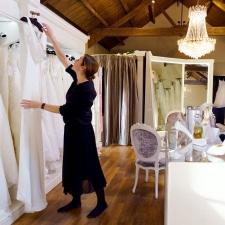 Sam at Sass and Grace Bridal Boutique Shop with Wedding Dresses